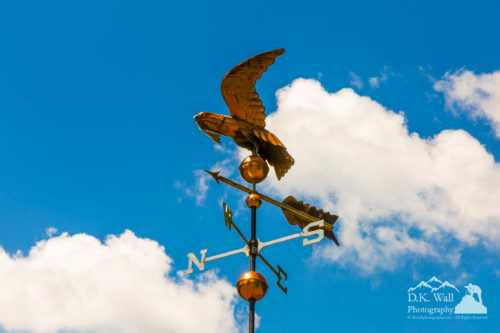 Weather Vane On Blue Sky