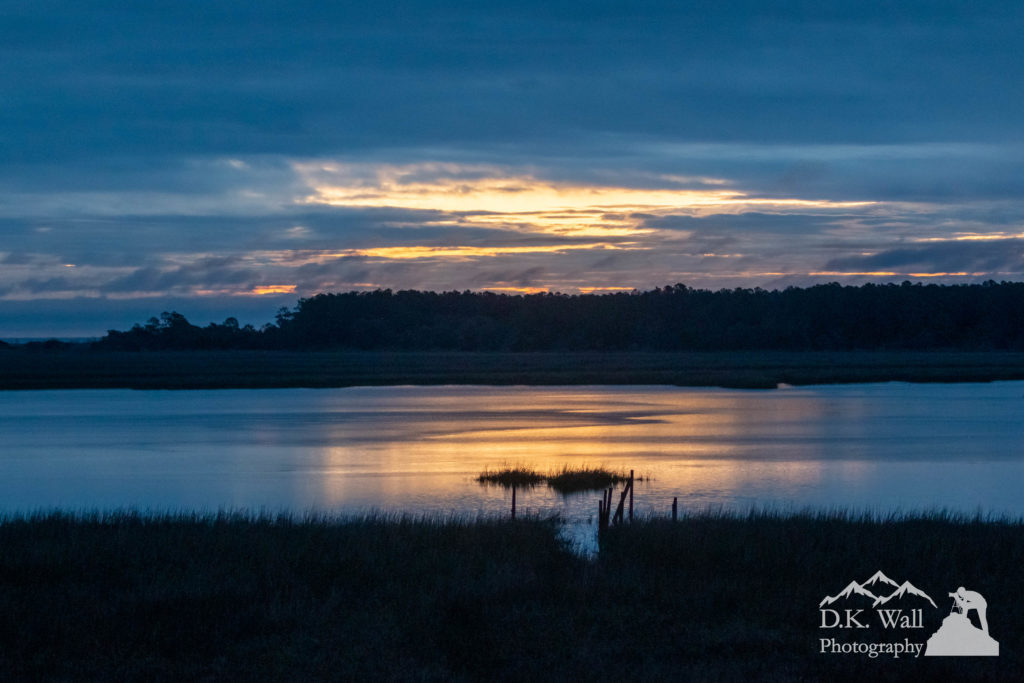 The rains stopped and the morning clouds broke up over the ocean, letting just a hint of sunrise glisten on the marsh.