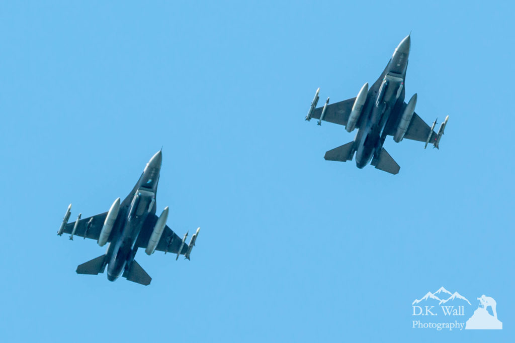 A pair of F-16's fly over in a salute to health workers